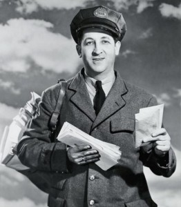 portrait_of_a_mailman_holding_letters_and_smiling_255-26057